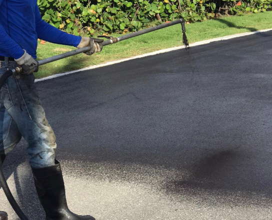 Sealcoating to seal in the pothole repair
